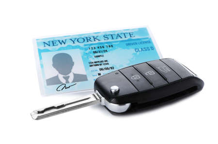 American driving license and car key on white background
