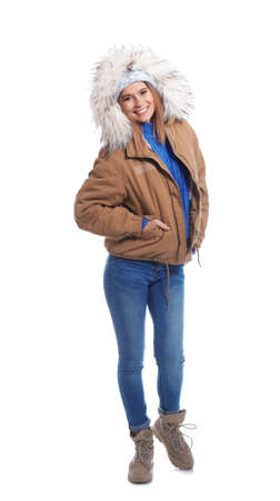 Young woman wearing warm clothes on white background. Ready for winter vacation