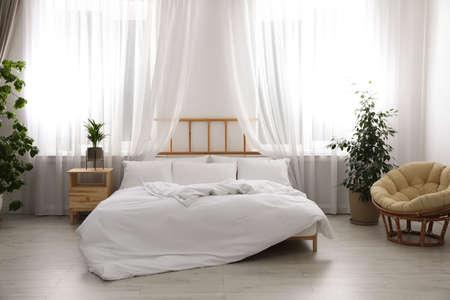 Light modern room interior with comfortable bed Archivio Fotografico