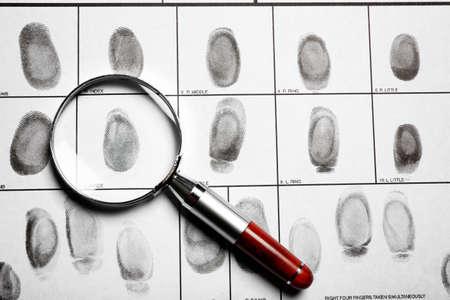 Criminal fingerprint card and magnifier, top view