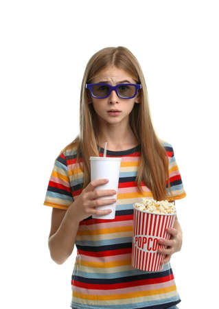 Emotional teenage girl with 3D glasses, popcorn and beverage during cinema show on white background