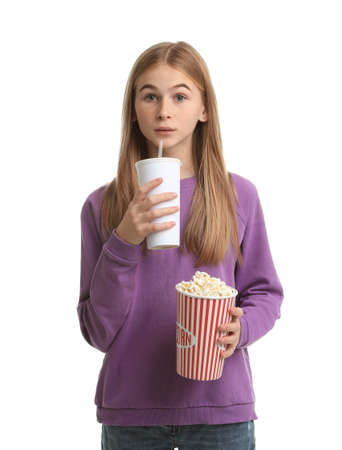 Emotional teenage girl with popcorn and beverage during cinema show on white background
