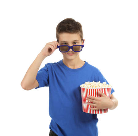Boy with 3D glasses and popcorn during cinema show on white background