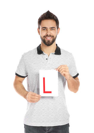 Young man with L-plate on white background. Getting driving license