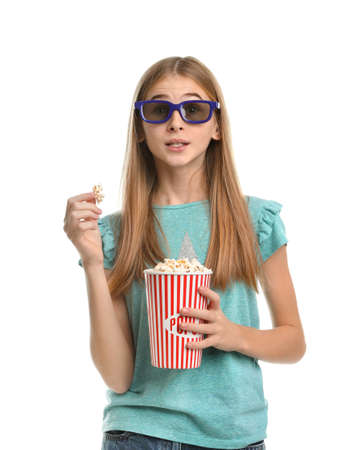 Emotional teenage girl with 3D glasses and popcorn during cinema show on white background