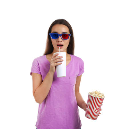 Emotional woman with 3D glasses, popcorn and beverage during cinema show on white background