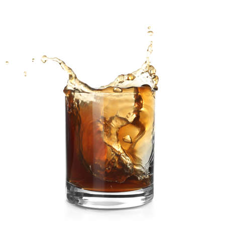Glass of expensive whiskey with splash on white background