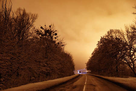 Beautiful view of twilight over country road. Winter landscape