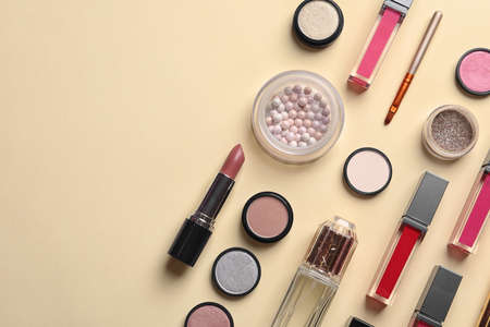 Beautiful composition with lipsticks on color background, flat lay. Space for text Imagens