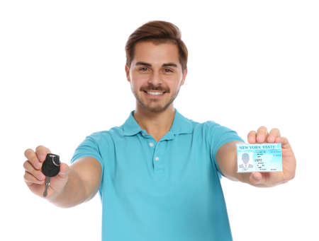 Happy young man with driving license and car key on white background
