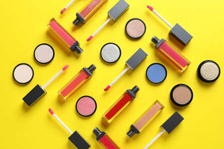 Composition with lipsticks on color background, flat lay