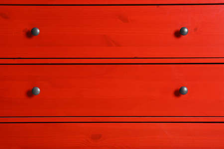 Red wardrobe drawers as background, closeup view Stock Photo