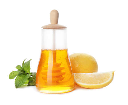 Jar of honey, mint and lemons on white background. Cough remedies Stock Photo