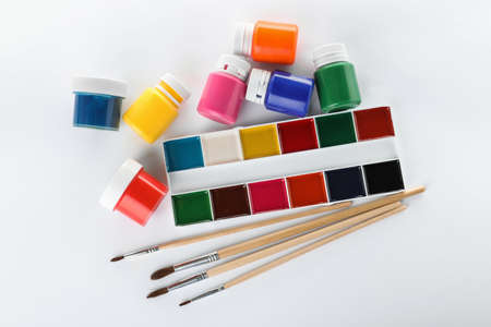 Paints and brushes for children on white background, top view Stock Photo