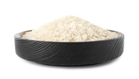 Plate with uncooked rice on white background Stock Photo