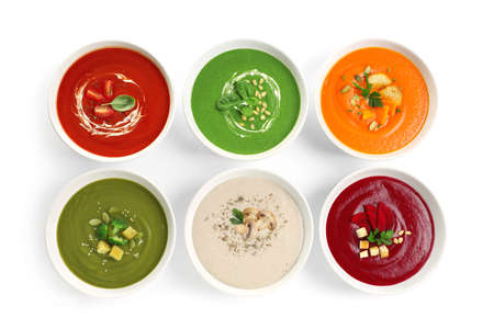 Various soups in bowls on white background, top view. Healthy food