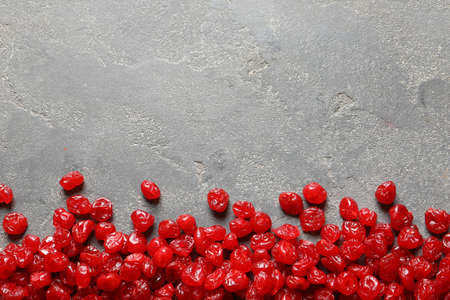 Cherries on color background, top view with space for text. Dried fruit as healthy snack