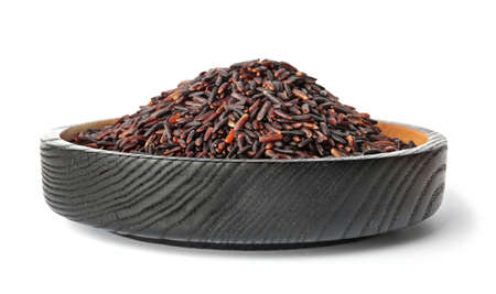 Plate with uncooked black rice on white background Stock Photo