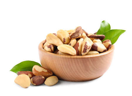 Brazil nuts in wooden bowl on white background 스톡 콘텐츠