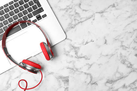 Flat lay composition with headphones, laptop and space for text on marble background Stock fotó