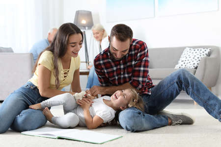 Young couple spending time with their daughter at home. Happy family Stok Fotoğraf