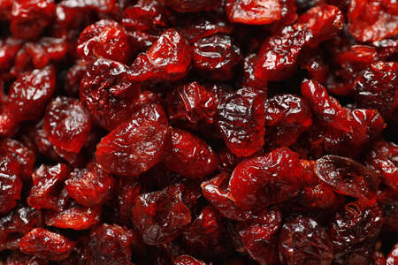 Tasty cranberries as background, top view. Dried fruits as healthy snack Stock Photo