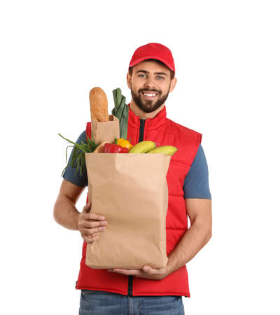 Man holding paper bag with fresh products on white background. Food delivery service