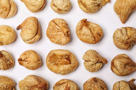 Flat lay composition with dried figs on  white background. Healthy fruit Banco de Imagens