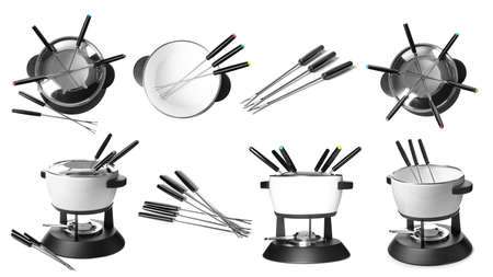 Set of modern fondue pots and forks on white background