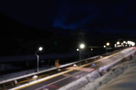 Blurred view of road with snow on sides at night Stock Photo