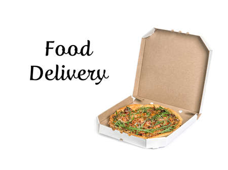 Cardboard box with delicious pizza on white background. Food delivery 免版税图像