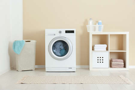 Washing of different towels in modern laundry room Archivio Fotografico - 115944049