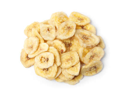 Heap of sweet banana slices on white background, top view. Dried fruit as healthy snack Imagens