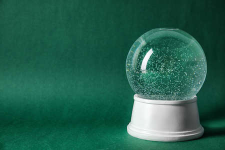 Magical empty snow globe on color background. Space for text