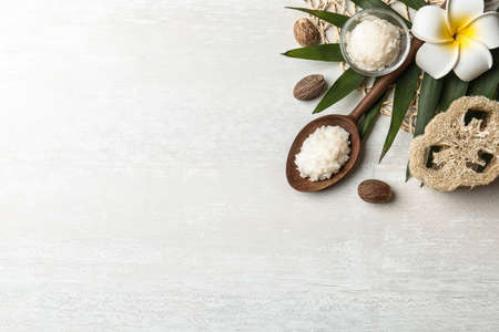 Flat lay composition with Shea butter and nuts on light background. Space for text Stock fotó