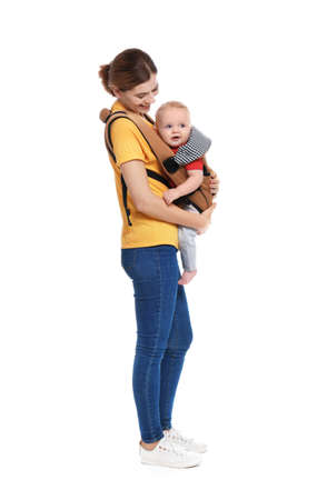 Woman with her son in baby carrier on white background Imagens