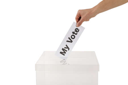 Man putting his vote into ballot box on white background, closeup