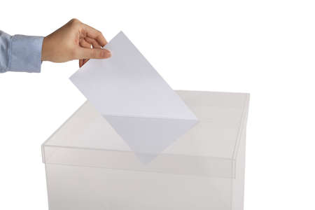 Woman putting her vote into ballot box on white background, closeup 免版税图像