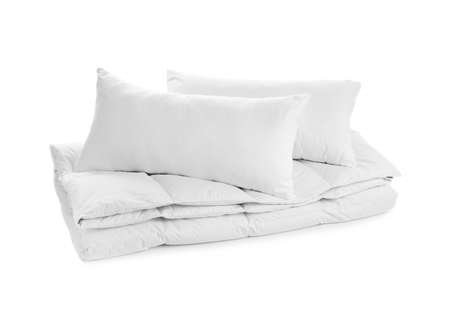 Soft blanket and pillows on white background Imagens