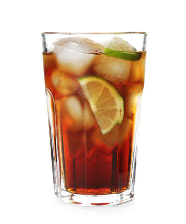 Glass of cocktail with cola, ice and cut lime on white background Фото со стока