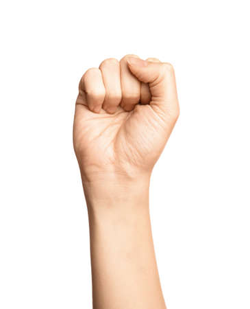 Woman showing S letter on white background, closeup. Sign language