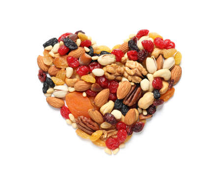 Heart made of dried fruits and nuts on white background, top view 写真素材