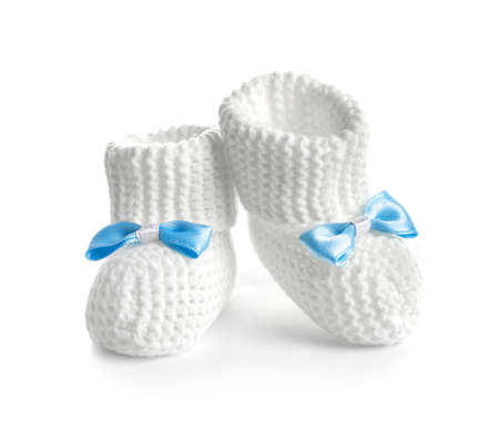 Handmade baby booties with bows isolated on white background