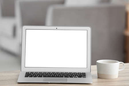 Laptop with blank screen on table indoors. Space for text Stok Fotoğraf