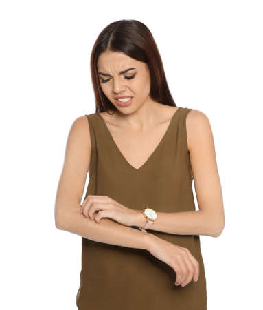 Young woman scratching arm on white background. Annoying itch
