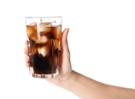 Woman holding glass of refreshing cola with ice on white background, closeup Archivio Fotografico
