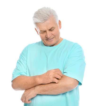 Mature man scratching arm on white background. Annoying itch