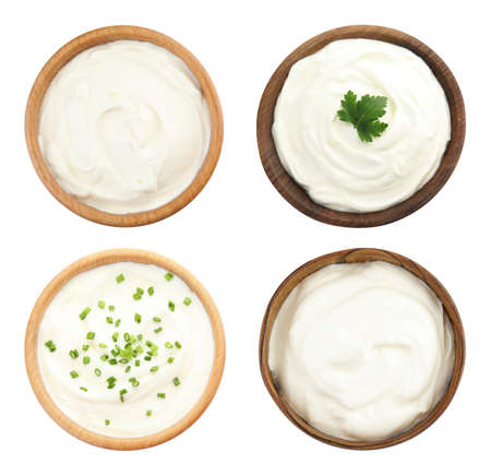 Set of delicious sour cream in bowls on white background, top view Reklamní fotografie