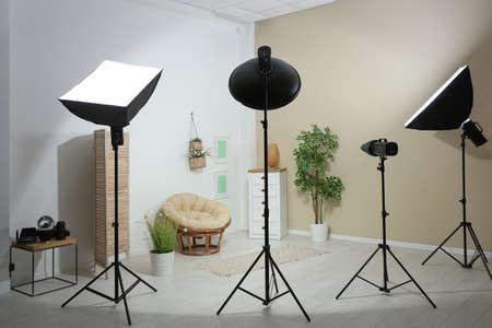 Example of living room interior design and professional equipment in photo studio