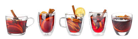 Set of traditional Christmas mulled wine in different glasses on white background 写真素材